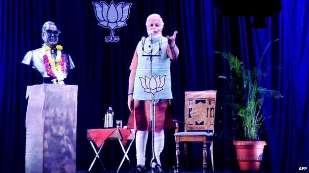 "An image of Bharatiya Janata Party  prime ministerial candidate Narendra Modi pictured during a live ""3D hologram"" telecast in Mumbai."