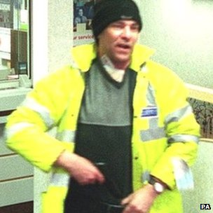 Michael Wheatley during an armed robbery in 2002, picture issued by the Metropolitan Police