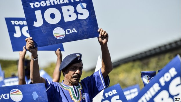 Supporters of South Africa's main opposition party Democratic Alliance (DA) wave placards asking for jobs