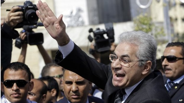 Hamdeen Sabahi greets supporters as he arrives at his campaign headquarters in Mahala, north of Cairo, on 5 May 2014