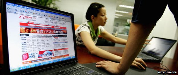 A photo showing Alibaba website on a computer screen