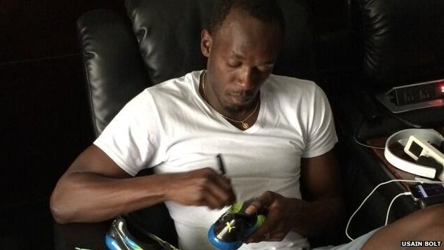Usain Bolt signing a new pair