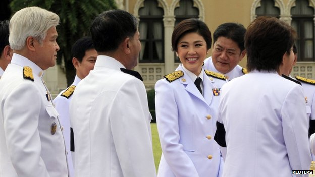 File photo: Prime Minister Yingluck Shinawatra with members of her new cabinet at Government House in Bangkok, 10 August 2011