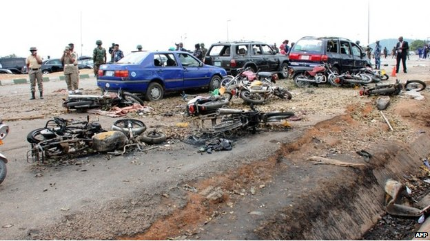 Burnt vehicles and motorcycles after an attack in Abuja, Nigeria (14 April 2014)