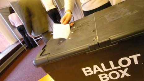 Woman casting vote in ballot box