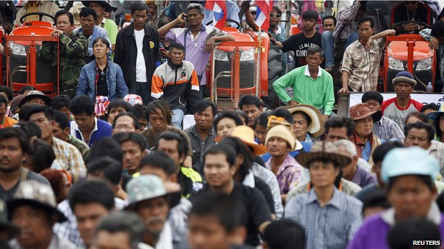 Rice farmers in Ayutthaya listen to a leader's speech on their way to a protest in Bangkok
