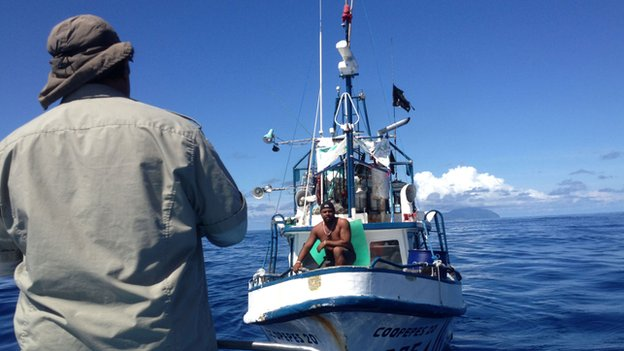 A fisherman is stopped by rangers in the no-fishing zone off Cocos Island