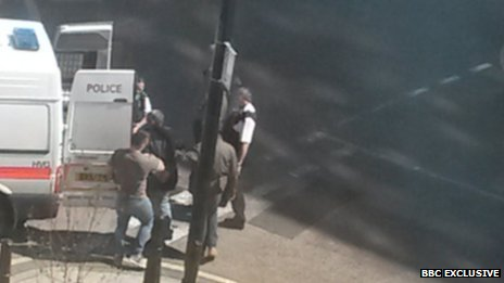 Police at arrest scene