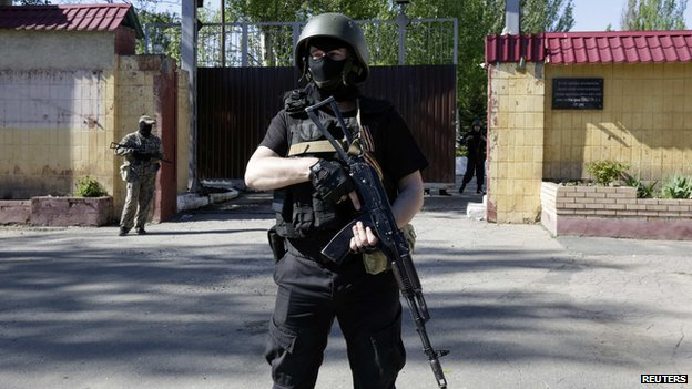 Pro-Russian armed separatists guard a street near an administrative building in Donetsk May 6, 2014