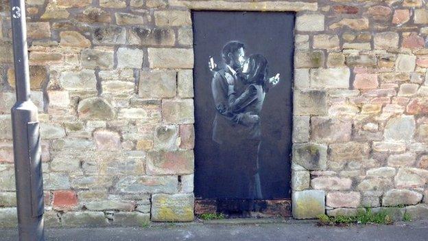 Banksy's Mobile Lovers