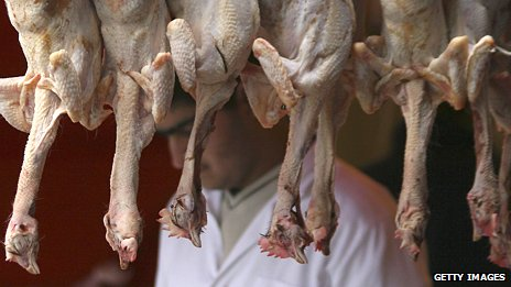 Halal chickens hang in an east London butcher's shop