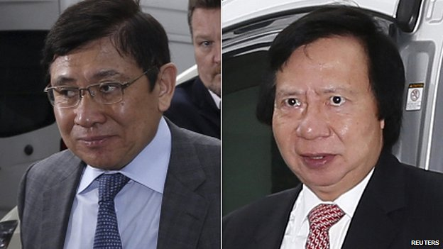 Raymond Kwok (L) and Thomas Kwok arrive at court in Hong Kong. 8 May 2014