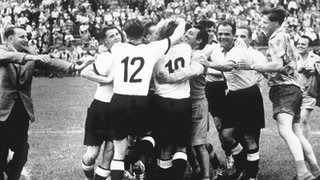 West Germany celebrate after completing an incredible comeback against Hungary