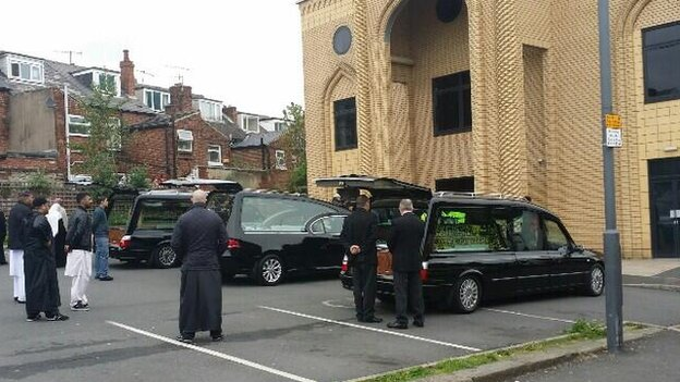 Hearses outside mosque