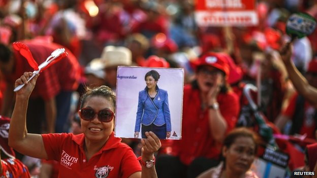 "A member of the pro-government ""red shirt"" group during a rally in Nakhon Pathom province on the outskirts of Bangkok, 6 April 2014"