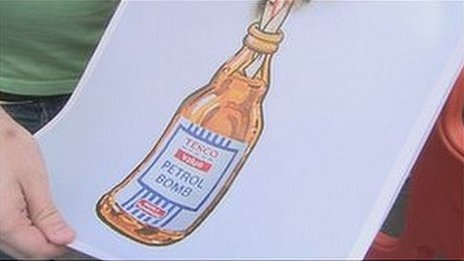 Fan holding Banksy print of Tesco Value petrol bomb
