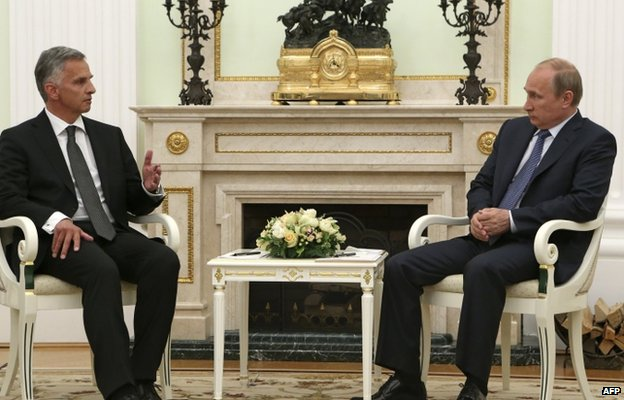 Russia's President Vladimir Putin (R) speaks with the head of the Organisation for Security and Cooperation in Europe (OSCE), Swiss President Didier Burkhalter, as they meet in the Kremlin in Moscow, on May 7, 2014.