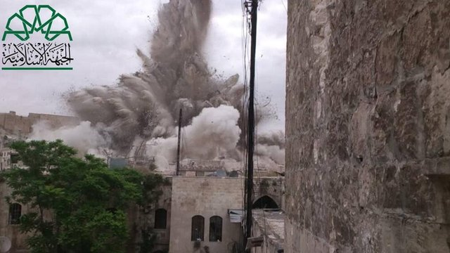 Photograph posted by Liwa al-Tawhid rebel group purportedly showing explosion underneath Carlton Citadel Hotel in Aleppo on 8 May 2014