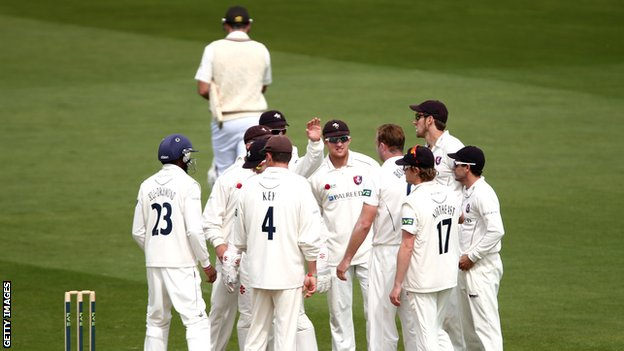 Kent players celebrate the departure of Surrey batsman Graeme Smith
