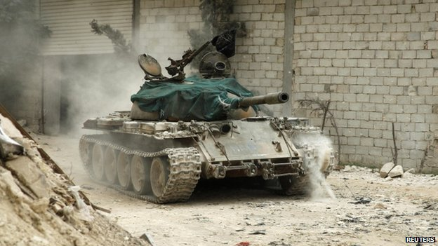A military vehicle that belongs to the Free Syrian Army is seen in Al-Amariya district in Aleppo, 8 May 2014