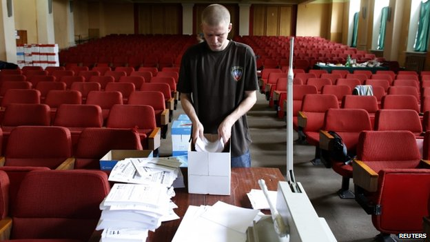 An election worker at the Donetsk self-proclaimed republic's election commission arranges referendum materials in Donetsk, 8 May
