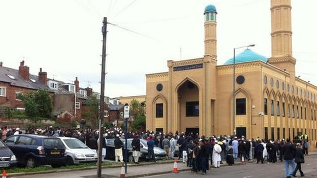 Mourners waiting outside mosque