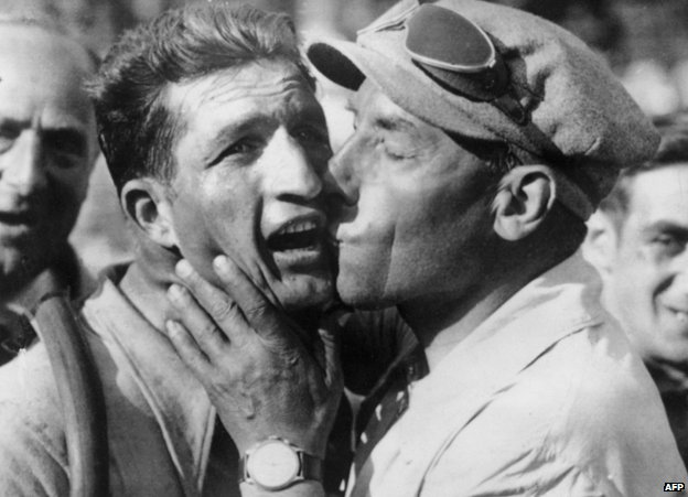 Gino Bartali is congratulated by Costante Girardengo after winning the eleventh stage of the Tour de France