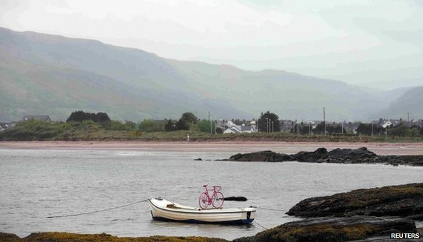A pink bicycle was strapped to a fishing boat near the village of Cushendall