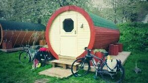 bikes outside a cabin with a round door