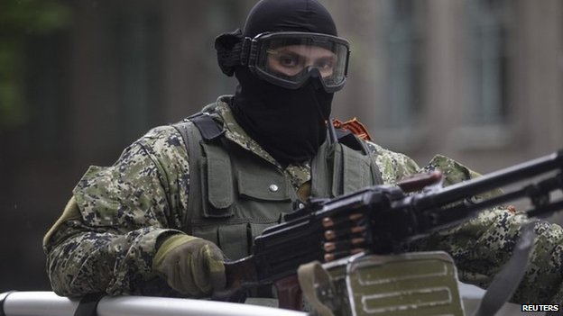 Pro-Russian armed man rides in a car in Sloviansk, 8 May