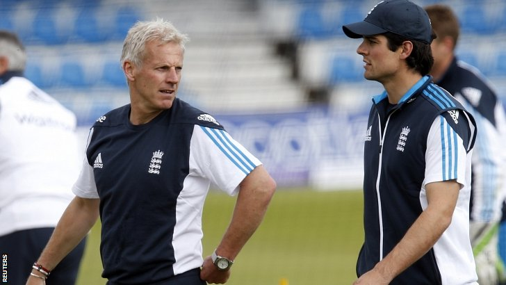 Peter Moores and Alastair Cook during net practice on Thursday