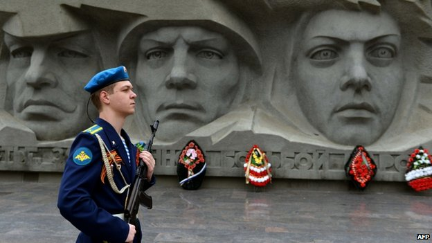 An honour guard stands at attention near a World War II monument in the southern Russian city of Stavropol
