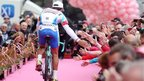 A member of the Italian-based Androni Giocattoli-Venezuela team is greeted by spectators during the Giro d'Italia opening ceremony