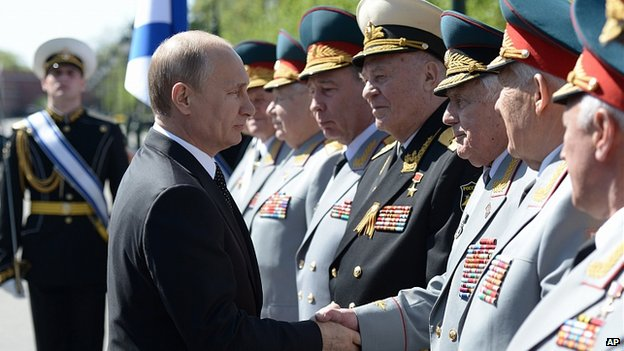 Vladimir Putin greets officers at wreath laying ceremony at Tomb of Unknown Soldier at the Kremlin wall