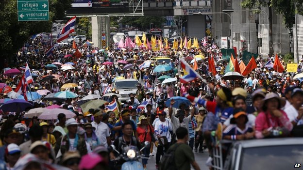 Anti-government protesters march through a main road in downtown Bangkok, Thailand, on 9 May 2014