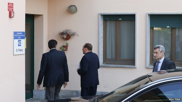 Silvio Berlusconi enters the San Pietro care home in Cesano Boscone (9 April 2014)