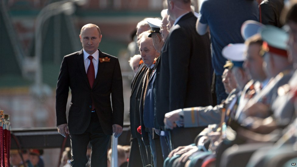 Russian President Vladimir Putin arrives to attend a Victory Day parade, which commemorates the 1945 defeat of Nazi Germany, in Moscow, Russia, 9 May 2014