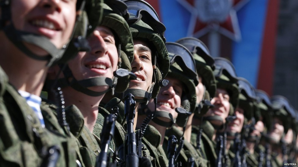 Russian servicemen march during the Victory Day parade in Moscow's Red Square, 9 May 2014