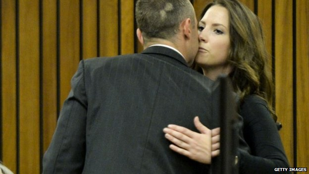Oscar Pistorius is greeted by his sister, Aimee, at the Pretoria High Court on 9 May 2014