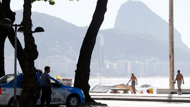 Police watch out over Copacabana beach in Rio