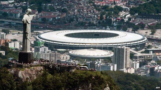 Christ the Redeemer statue atop Corcovado Hill and the Mario Filho (Maracana) stadium in Rio de Janeiro