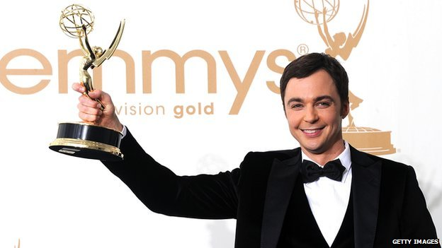 Jim Parsons from The Big Bang Theory holds an Emmy in the air