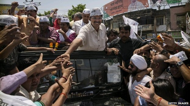Arvind Kejriwal greets supporters in Varanasi