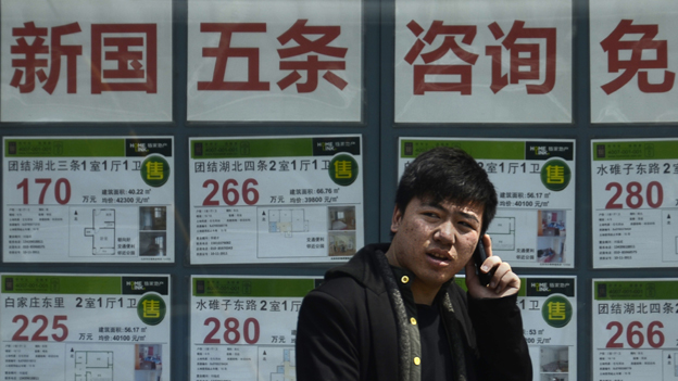 A man outside an estate agency in China