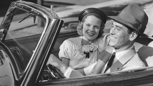 couple in convertible car in 1950s