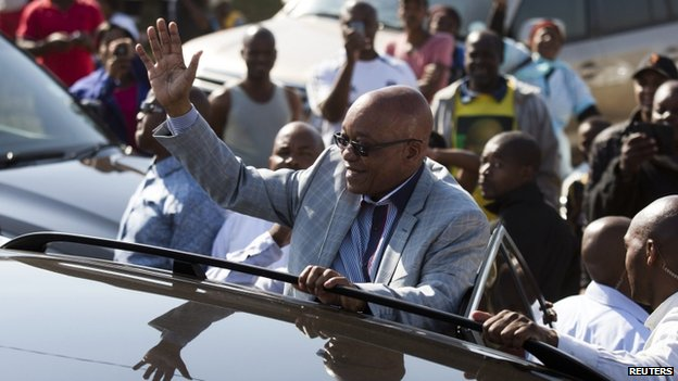 South African President Jacob Zuma greets supporters of African National Congress after voting at a voting station in the Nkandla district, 7 May 2014