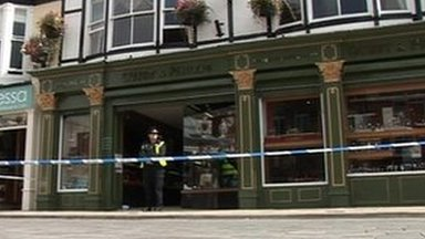Police officer outside of jewellers