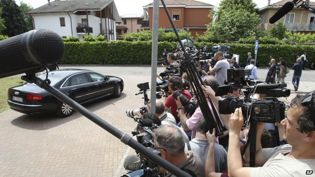 Reporters gather outside the care home where former Italian Premier Silvio Berlusconi was ordered to perform four hours of community service a week for a year