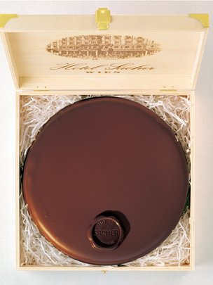 A sachertorte from Hotel Sacher being boxed for sale