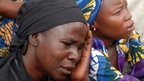 Mothers of the missing Chibok schoolgirls abducted by Boko Haram Islamists gather to receive information from officials on 5 May 2014